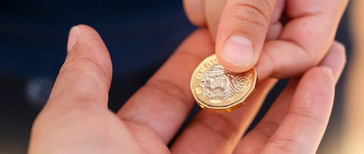 one pound in hand